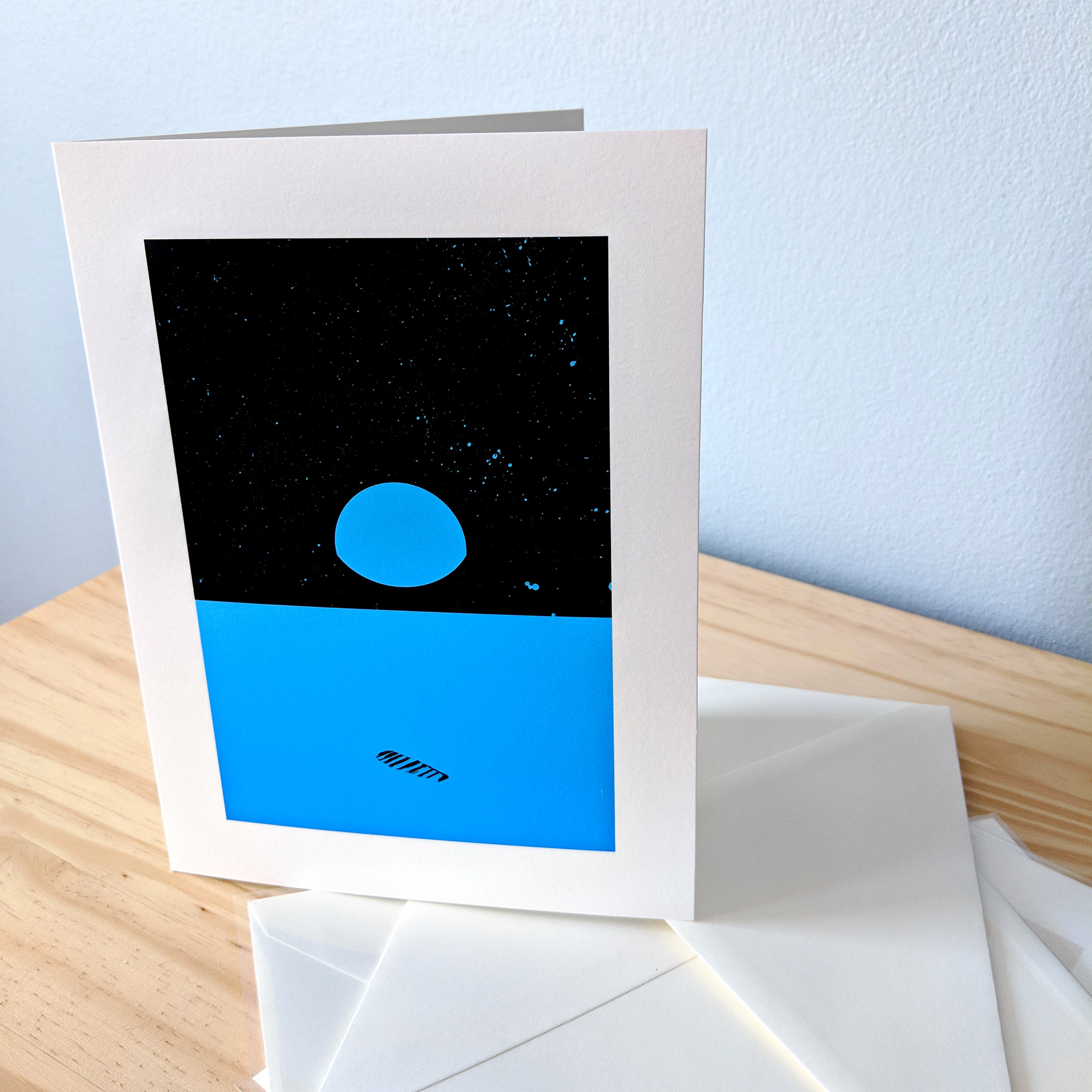 Sample art card with envelope. Art is of Earth from the moon.